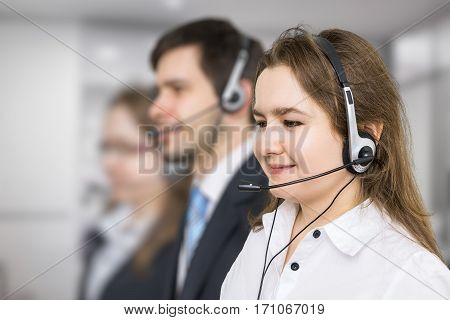 Young Smiling Woman - Operator In Call Center. Telemarketing And