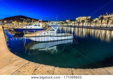 Night view at Split coastal town in Croatia, famous european travel resort on Adriatic Sea.