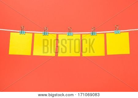 Blank Yellow Paper Sheets On The String