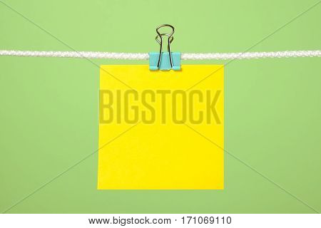 Blank Yellow Paper Sheet On The String