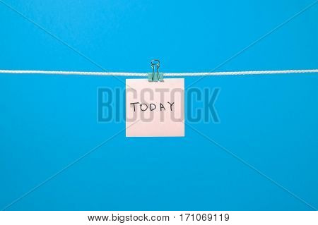 "Pink Paper Note Hanging On The String With Text ""today"""