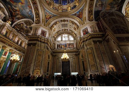 SAINT-PETERSBURG RUSSIA - JANUARY 03 2017: Tourists visiting the interior of Saint Isaac's Cathedral.