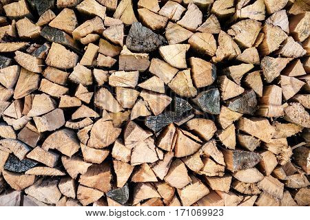 Firewood stacked in a woodpile. Abstract background