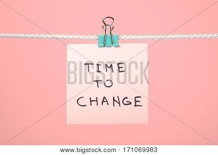 "Pink Paper Note Hanging On The String With Text ""time To Change"""