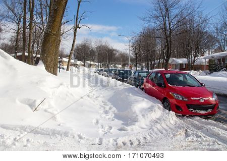 Sorel-Tracy Canada-13 February 2017 : Sorel-Tracy street after a snowfall in daytime outdoor with cars parked on the street. Sorel-Tracy is a small town of the province of Quebec in Canada