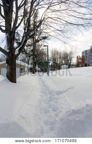 snow trail on town at winter after a snowfall Sorel-Tracy Quebec Canada