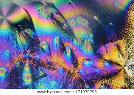 Colorful micro crystals through the microscope in polarized light