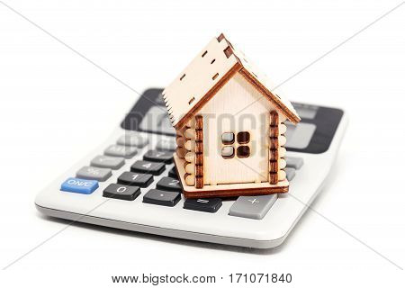 House and calculator on a white background. Construction costs