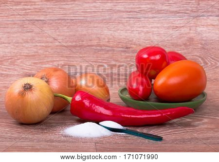 collection of fresh raw vegetables on wooden background