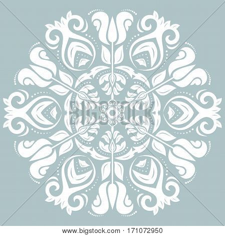 Oriental round pattern with arabesques and floral elements. Traditional classic ornament. Light blue and white pattern