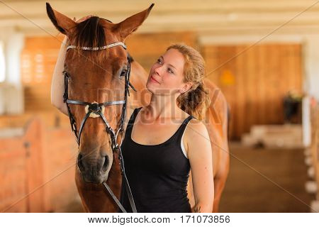 Jockey Young Girl Petting And Hugging Brown Horse