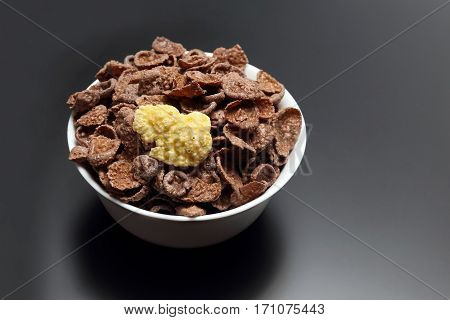 the corn flakes in a white bowl
