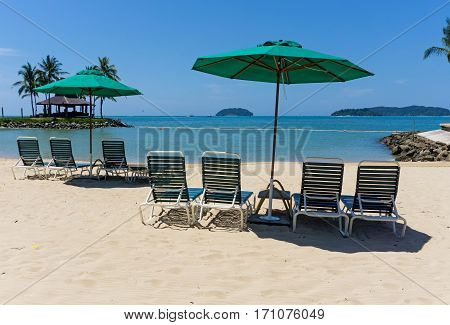 Lounge Chairs With Sun Umbrella On A Beach In Kota Kinabalu, Sabah Borneo, Malaysia.