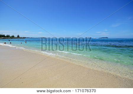 Blue Sky And Turquoise Water At Kota Kinabalu Beach, Sabah Borneo, Malaysia.