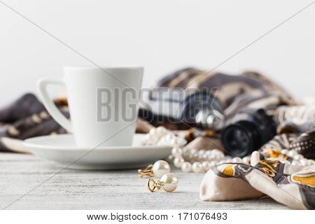 Breakfast In Cafe With Coffee Cup And Scarf On Table