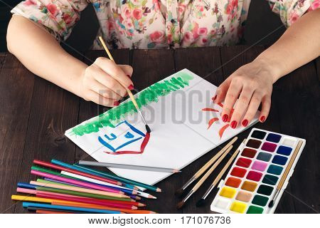 Woman Drawing Family House As Concept Of Estate