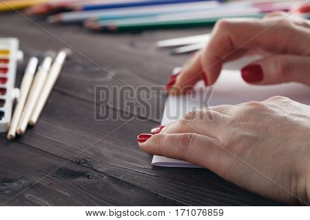 Woman Do Origami, Bend Paper Sheet For Do Figure