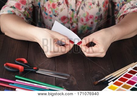 Woman Fold Sheet Of Paper While Do Origami