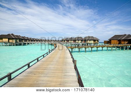 Wooden water bungalows in tropical  Maldives island