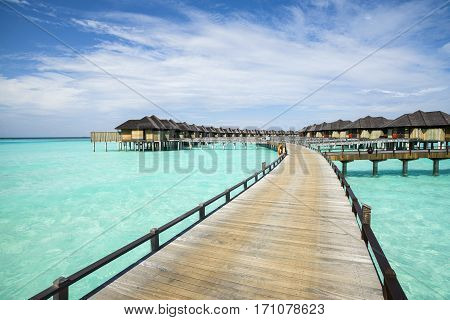 Wooden water bungalows in Indian ocean, Maldives island