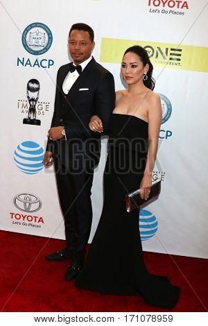 LOS ANGELES - FEB 11:  Terrence Howard, Miranda Pak at the 48th NAACP Image Awards Arrivals at Pasadena Conference Center on February 11, 2017 in Pasadena, CA