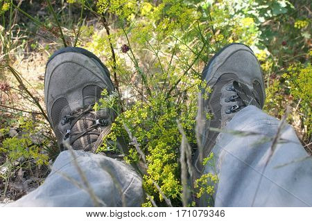 A pair of mountaineer's boots into the grass
