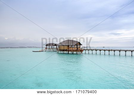 Wooden water bungalow at sunset, Maldives island