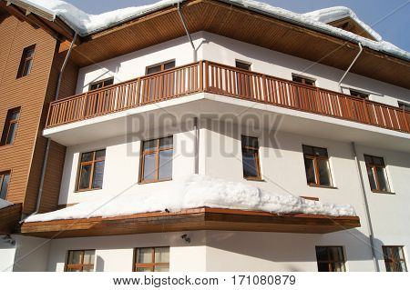 House in the snow. Houses and hotels in mountain-skiing village of Rosa Khutor.