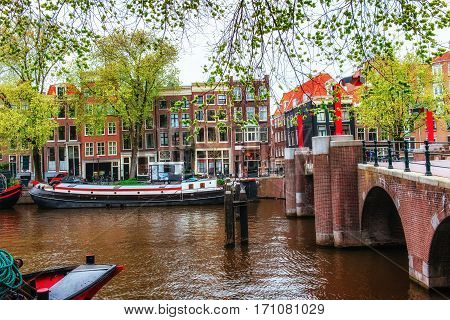 Amsterdam canals and typical houses. Amsterdam is the capital and most populous city in Netherlands.