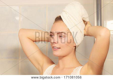 Woman In Towel On Her Head In Bathroom