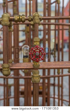 Copper Pipes And Valves On The Background