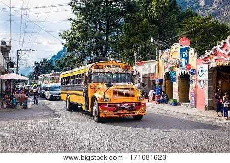 ANTIGUA,GUATEMALA -DEC 24, 2015:Typical guatemalan chicken bus in the steet of Antigua on Dec 24, 2015,Guatemala.Chicken bus It's a name for colorful, decorated bus in various latin American countries