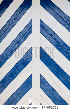 Blue and white chevron or zig zag pattern design on a wooden door