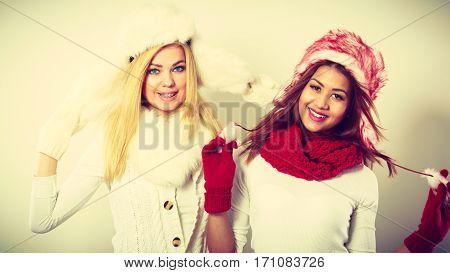Two Smiling Girls In Warm Winter Clothing.