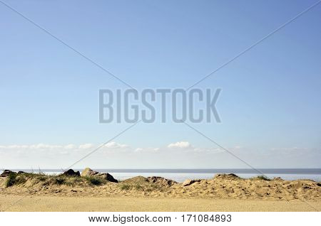 Sandy beach and foreshore seaside landscape at Heacham on the Norfolk coast.