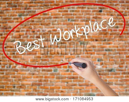 Woman Hand Writing Best Workplace With Black Marker On Visual Screen