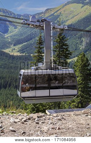 Cable car in the mountains wagon with tourists