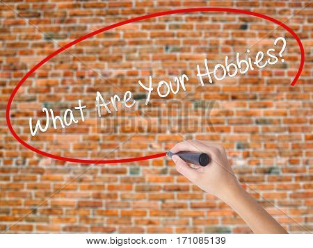 Woman Hand Writing What Are Your Hobbies? With Black Marker On Visual Screen