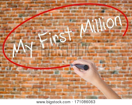 Woman Hand Writing My First Million With Black Marker On Visual Screen