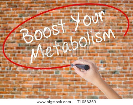 Woman Hand Writing Boost Your Metabolism With Black Marker On Visual Screen