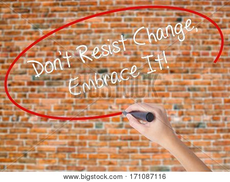 Woman Hand Writing Don't Resist Change, Embrace It! With Black Marker On Visual Screen