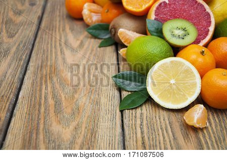 Fresh juicy citrus fruits on a wooden background