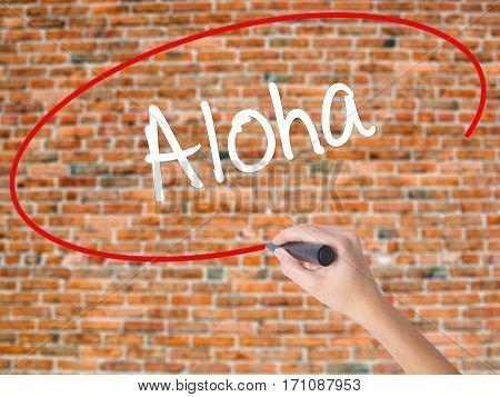 Woman Hand Writing Aloha  With Black Marker On Visual Screen