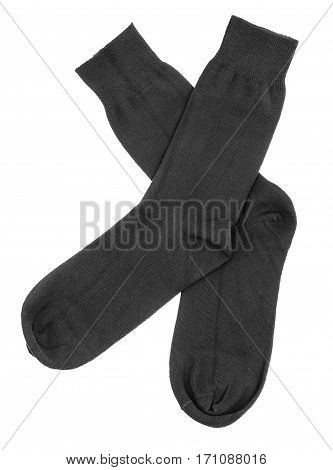 Pair of black socks crossed isolated on a white background. Clipping paths included.