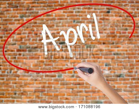 Woman Hand Writing  April  With Black Marker On Visual Screen