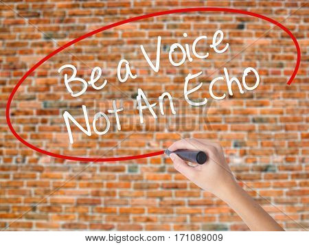Woman Hand Writing Be A Voice Not An Echo With Black Marker On Visual Screen