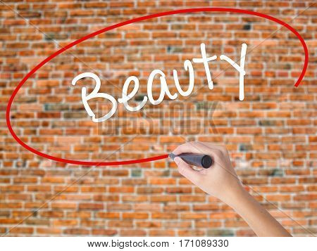 Woman Hand Writing Beauty  With Black Marker On Visual Screen