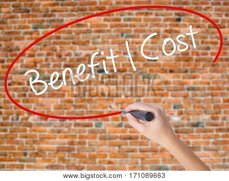 Woman Hand Writing Benefit Cost With Black Marker On Visual Screen