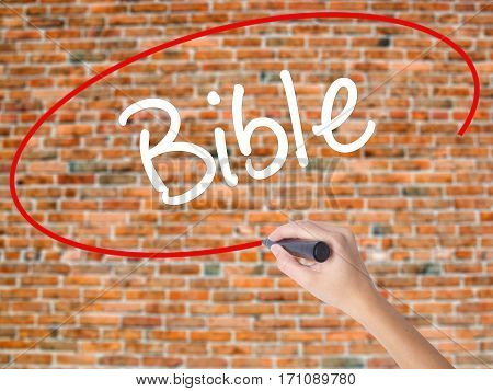 Woman Hand Writing Bible With Black Marker On Visual Screen