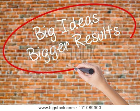 Woman Hand Writing Big Ideas Bigger Results  With Black Marker On Visual Screen
